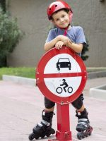 Cheerful child on his roller skate